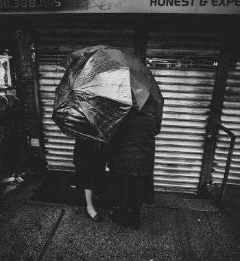 Three women in rain