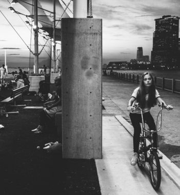 Girl on a bike. Brooklyn